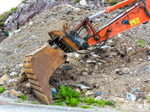 Excavator digger shovel on construction site Royalty Free Stock Images