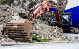 Excavator digger shovel on construction site Stock Photos