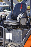Excavator digging chair Stock Images