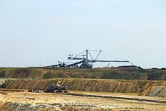 Excavator digging coal on open pit coal mine Kostolac Serb Stock Photos
