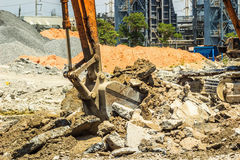 Excavator digging the concret Royalty Free Stock Images