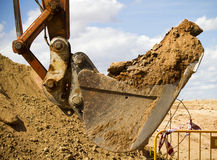Excavator digging a deep trench, working, sand Royalty Free Stock Photos