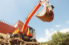 Excavator is digging a ditch Royalty Free Stock Photography