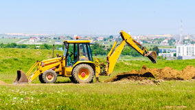 Excavator digging hole Stock Photo