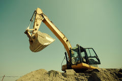 Excavator digging Stock Photos
