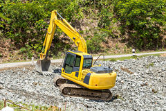 Excavator digging rock Royalty Free Stock Photography