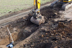 Excavator digging trench Royalty Free Stock Image