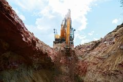 Excavator digging a trench for the pipeline. Excavation royalty free stock photo