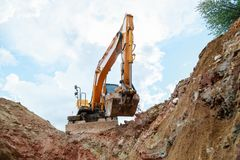 Excavator digging a trench for the pipeline. Excavation stock images