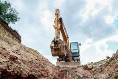 Excavator digging a trench for the pipeline. Excavation stock photos