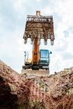 Excavator digging a trench for the pipeline. Excavation stock photography