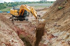 Excavator digging a trench for the pipeline. Excavation royalty free stock photography