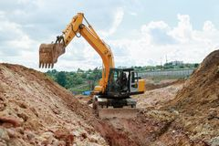Excavator digging a trench for the pipeline. Excavation stock image