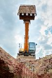 Excavator digging a trench for the pipeline. Excavation royalty free stock image