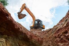 Excavator digging a trench for the pipeline. Excavation stock photo
