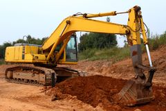 Excavator digging up some ground and rocks #2 Royalty Free Stock Photos