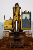 Excavator digging up some ground and rocks Royalty Free Stock Images