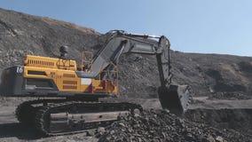 Excavator digs on a coal mine.  stock footage