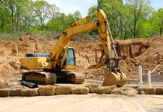 An Excavator Digs A Fresh Hole in the Earth Royalty Free Stock Images