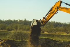 Free Excavator Digs The Ground. Part Of Construction Earthmoving Equipment. Digging The Soil With An Excavator Bucket Stock Image - 156214691