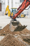 Excavator dipper at construction site Stock Photography