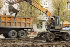 Excavator. Downloads the old tram sleepers royalty free stock image