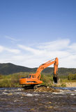 Excavator dredging Royalty Free Stock Images