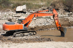 Excavator dredging sediment mud Royalty Free Stock Images