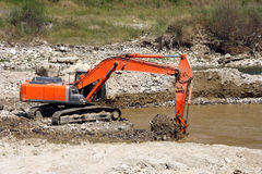 Excavator dredging sediment mud Stock Photos