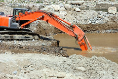Excavator dredging sediment mud Stock Images