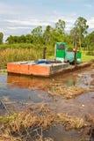 Excavator dredging sediment mud Royalty Free Stock Photography