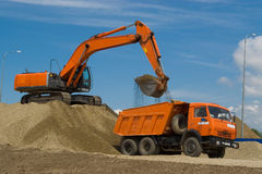 Excavator and dump truck. At the building site royalty free stock photos