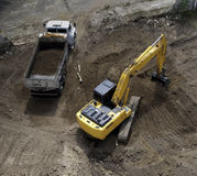 Excavator and Dump Truck. Excavator loading dump truck fill of dirt stock photography
