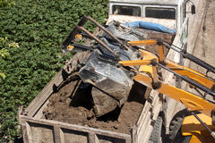 Excavator and dump truck. Excavator Dumping Dirt into Dump Truck Royalty Free Stock Image