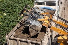 Excavator and dump truck. Excavator Dumping Dirt into Dump Truck Royalty Free Stock Image