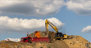 Excavator and dump truck skill work on construction of new highway. A stock video
