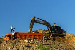 Excavator and dump truck skill work on construction of new highway. Moscow; Russia, August -eleventh-Two thousand sixteen year;  excavator and dump truck skill Stock Image