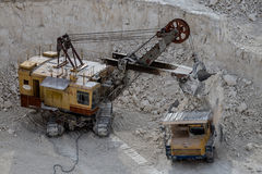 Excavator and dump truck working and extracting the chalk in a q Royalty Free Stock Photography