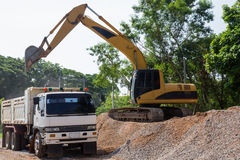 Excavator and dumper Royalty Free Stock Photo