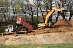 Excavator and dumper on road construction. Road construction machinery. Zhukovskiy, Russia - May 02, 2017: Editorial use only. Excavator and dumper on road Royalty Free Stock Photo