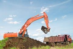 Excavator and dumper truck stock image