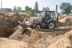 Excavator dumps the ground stock image