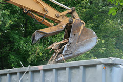 Excavator dumps waste Stock Photography