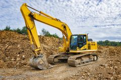 Excavator Earth Moving Equipment NOT CATERPILLER PRODUCT. Horizontal shot of Excavator Earth Moving Equipment. NOT CATERPILLER PRODUCT royalty free stock image