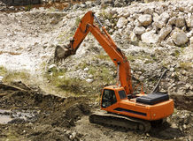 Excavator during earthmoving works Stock Photo