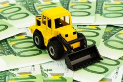 Excavator on euro banknotes Royalty Free Stock Photo