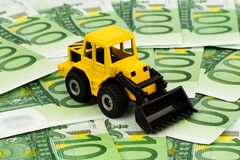 Excavator on euro banknotes Royalty Free Stock Photography