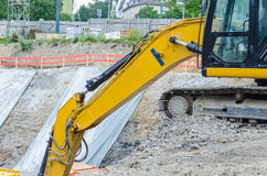 Excavator on the excavation. Large backhoe on construction site boundary at Excavation Stock Photography