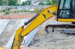 Excavator on the excavation Stock Photography