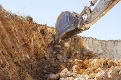 Excavator in exploitation Stock Photos